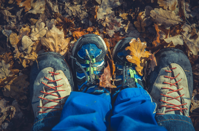 dad and child's feet wearing hiking shoes